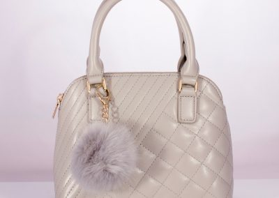 Pale Grey Quilted Kettle Bag with Pom Pom Charm